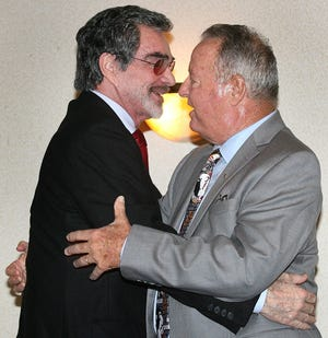 Legendary Hollywood film actor and former FSU football plyer Burt Reynolds greets FSU head football coach Bobby Bowden at the start of the Bobby Bowden Roast on July 15, 2009 at the University Center Club in Tallahassee, Fla.