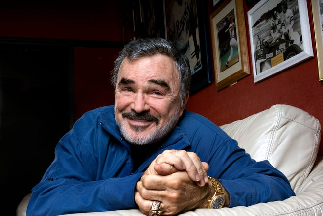 Actor Burt Reynolds takes a break during a 2008 interview at the Burt Reynolds and Friends Museum in Jupiter.