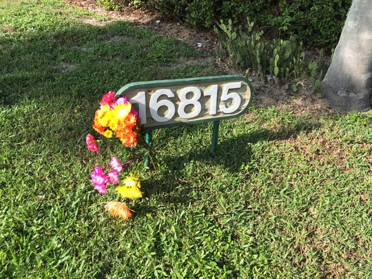Flowers rest in front of the home of Burt Reynolds in Tequesta, Florida, on Thursday, Sept. 6, 2018. The actor died Thursday at the age of 82.
