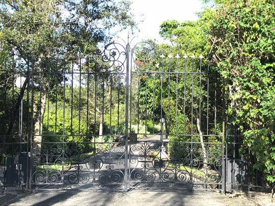 The gate to Burt Reynolds' estate in Tequesta is seen early Thursday evening, Sept. 6, 2018. Reynolds died Thursday at 82 years old.