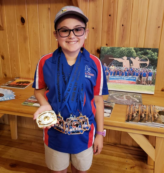 Molly Elliott, 11, of Lake Placid earned her second Rookie division national championship at the recent Scholastic Sporting Clays championships in Ohio.