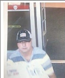 Surveillance photo of the suspect police believe broke into a car in the parking lot of the Planet Fitness in Stuart.