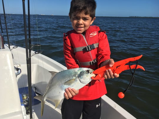 Eli, with a nice pompano caught while fishing for snapper and sheepshead.