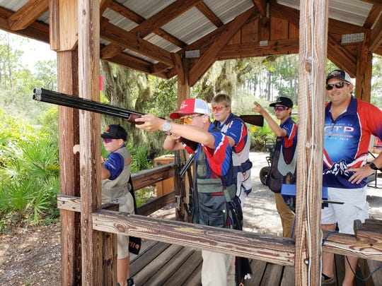 Kyle Barrett, 15, a sophomore at Okeechobee High School, takes aim at a clay target at Quail Creek Plantation in Okeechobee where he competes with the Young Guns of Quail Creek shooting sports team.