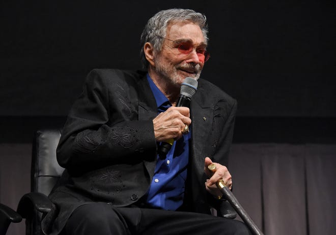 """All you really have in the end is your stories,"" the late Burt Reynolds said. In this file photo, Reynolds was presented with the Life Worth Living Legend Award on June 09, 2017, during the Vero Beach Wine and Film Festival in Vero Beach."