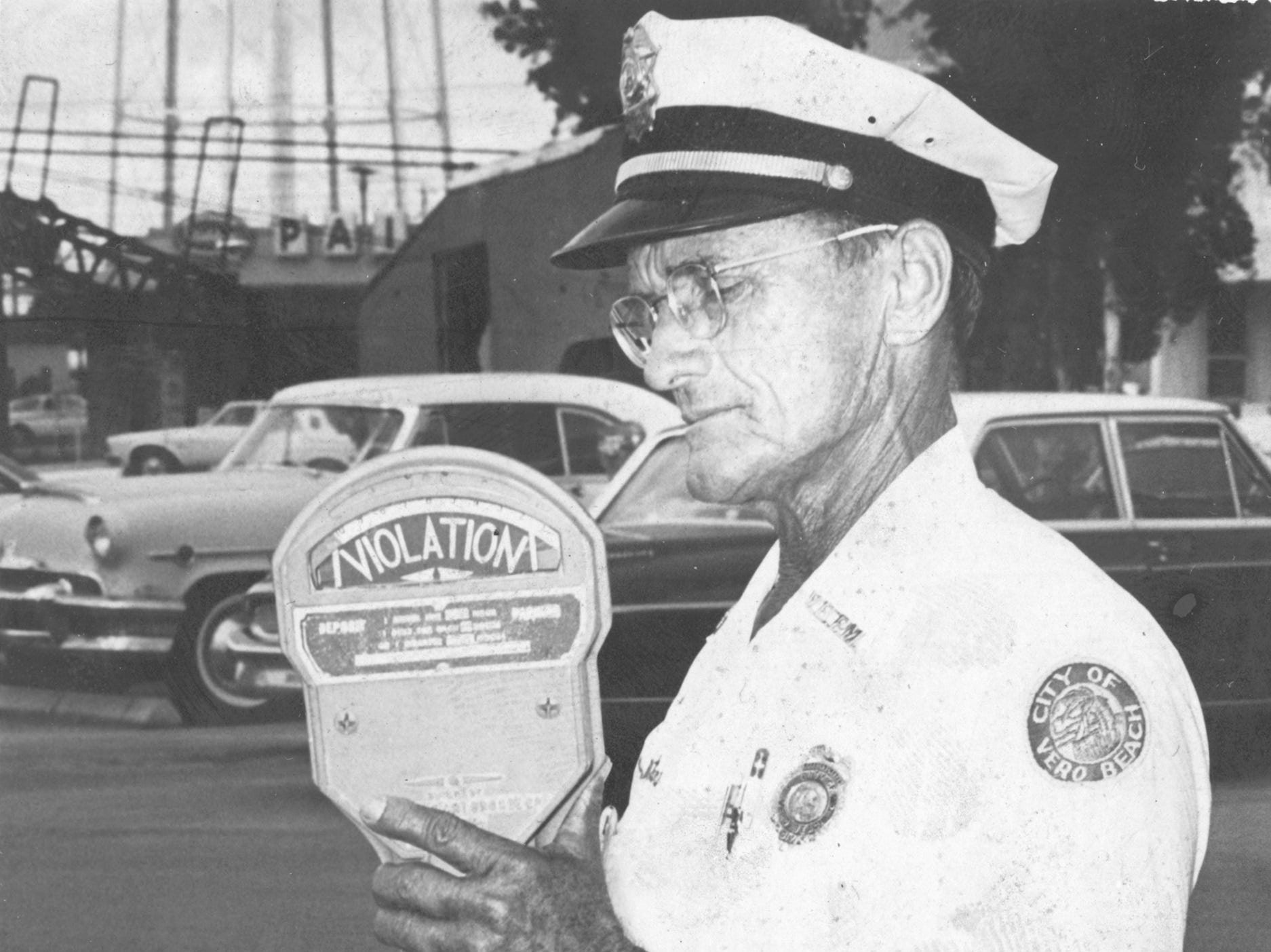 On June 6, 1963, the first parking meters were taken out of commission from the old Vero Beach City Hall parking lot under an agreement between the city and the Downtown Merchants Association. Paul Bishop, parking meter maintenance man, was shown with one of the meter heads he had just taken off.