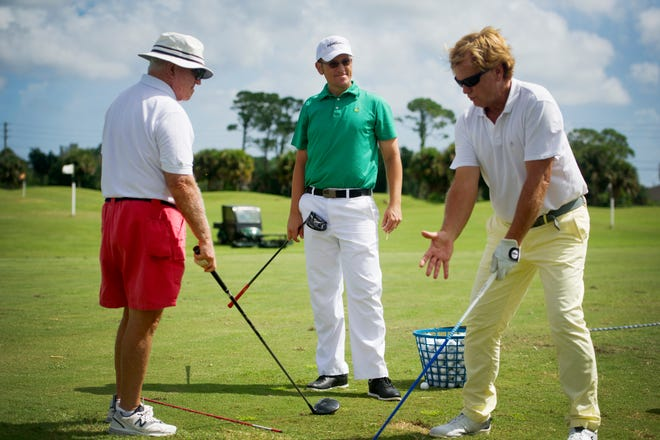 "James Muir (center) listens in as business partner Patrick Cerjan (right) gives instruction to Mickey Coffey on the driving range during a clinic at Pointe West Golf Club in Vero Beach. In May 2016, Muir was diagnosed with a malignant peripheral nerve sheath tumor, a rare type of cancer that occurs in the lining of the nerves that extend from the spinal cord into the body. The window of survival for someone diagnosed with this cancer is three to five years. Up until his diagnosis, Muir was the head professional at Pointe West but had to scale back his activities due to his cancer. Muir is this year's recipient of the Steven C. Owen Award, giving annually by the Indian River Golf Association to someone recognized ""for perseverance and overcoming adversity while using leadership skills to promote interest in the game of golf."""