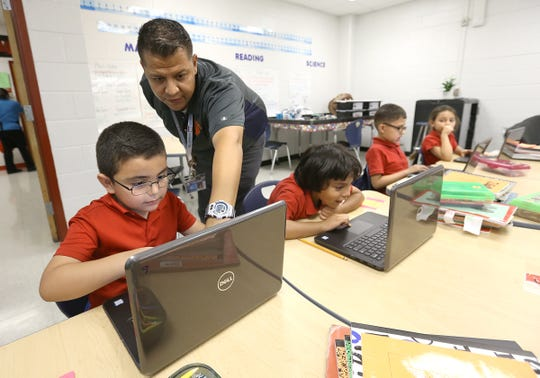 Teacher Elias Rangel Jr. works with students on a math app on their computers Thursday at Campestre Elementary School, 11399 Socorro Road.