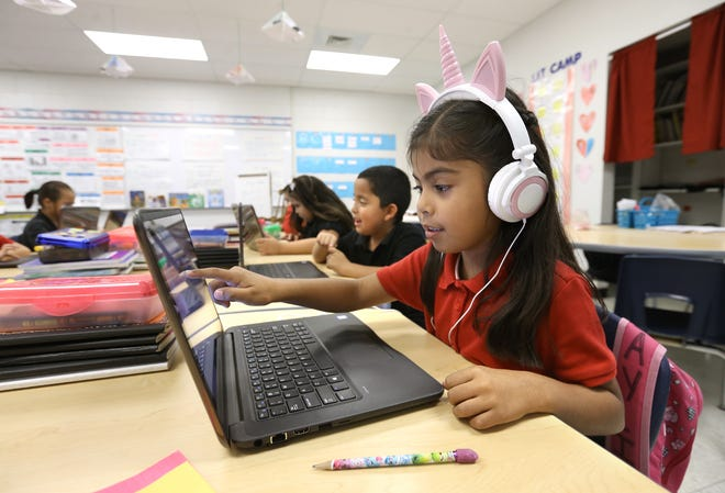 Anahiz Hernandez works on a math assignment on her laptop on Thursday at Campestre Elementary School, 11399 Socorro Road.