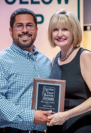 El Pasoan Juan Arvilla receives FastSigns Silver Sales Award from Catherine Monson, FastSigns International CEO, at the company's annual sales summit held Aug. 16-18 in Arlington, Texas.