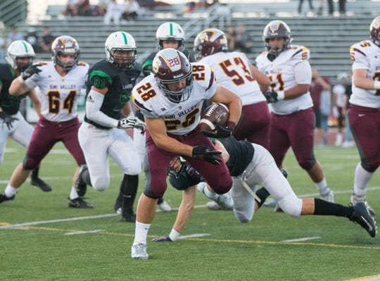 Jackson Sterling tries to break free of a Thousand Oaks defender during Simi Valley's win on Aug. 31.