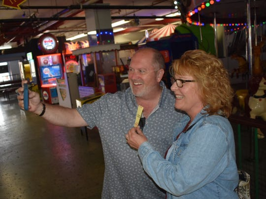 Kris Kaufmann and Katherine Hamilton take a selfie at the Ventura Harbor Village. They met after DNA tests indicated they are brother and sister.