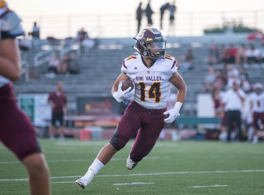 Simi Valley's Malik Hunt scans the field against Thousand Oaks on Aug. 31.