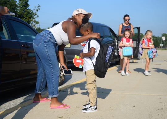 Shanese Fordham gives her son, Josiah, 5, a kiss before heading into Anthony Rossi Middle School on Thursday, September 6.