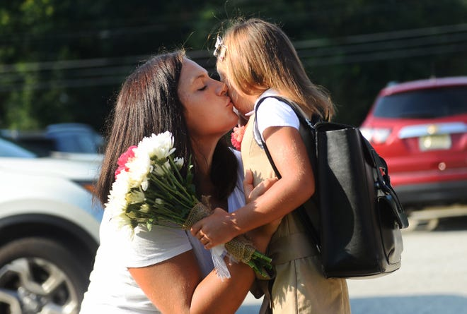 Alena Broshchan gives her daughter Sophia a kiss before heading into Anthony Rossi Middle School on Thursday, September 6.