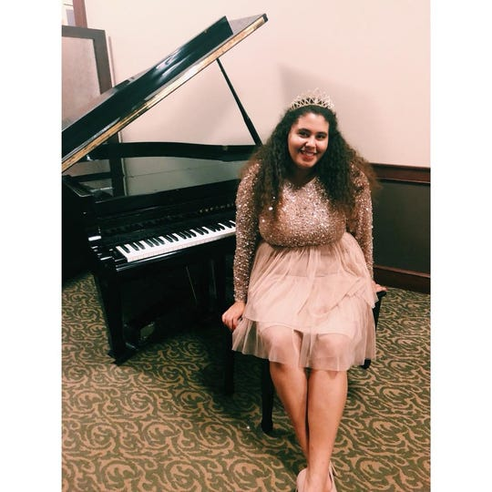 Kayley McColley became Wausau West High School's prom queen after fighting teachers for the right to highlight her biracial background in her campaign.