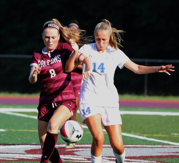 Albertus Magnus' Julianna Hanigan, left, fights for the ball with Bronxville's Rachael Peacock during their game at Albertus Sept. 5, 2018.