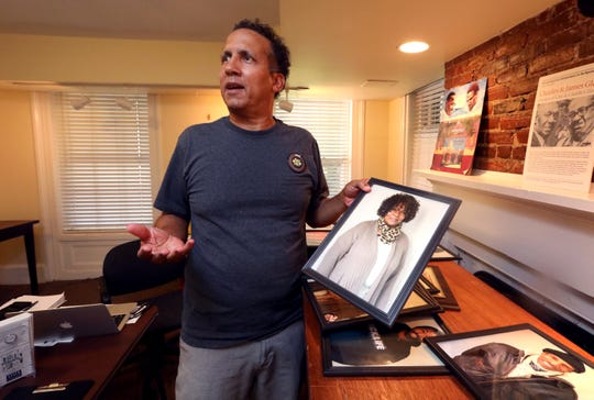 Bill Batson curator of the Nyack Record Shop Project holds a photo of Eunice Carter Turnbull at the Nyack Historical Society Sept. 5, 2018.