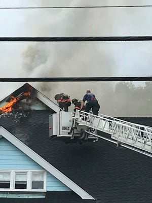 Yonkers firefighters battle a blaze at The Amackassin Club.