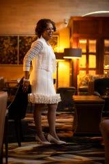 Sheila Marlowe wears a cream Donna Ricci dress with double-ruffled hem and back zipper, sheer cream sweater and Alfani peek-a-boo cream pumps.