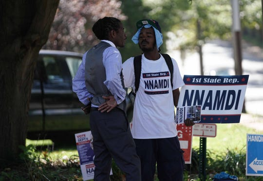 Nnamdi Chukwuocha, left, talks with a supporter before September's primary elections. Chukwuocha unseated incumbent Rep. Charles Potter in North Wilmington's 1st Representative District.