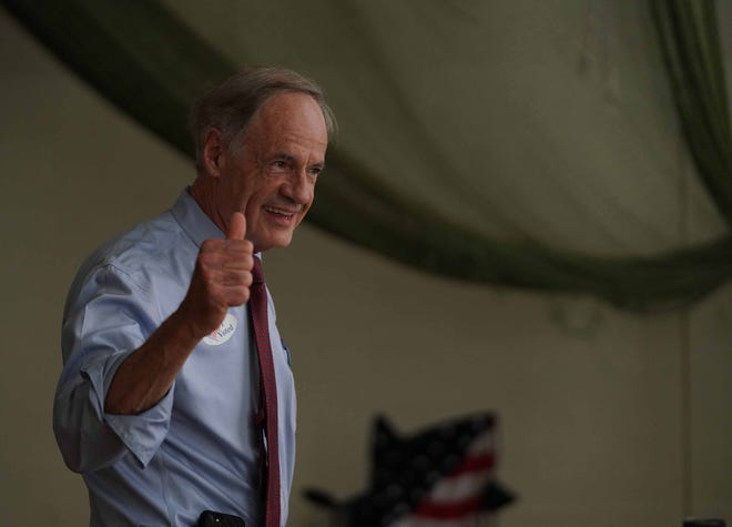 U.S. Sen. Tom Carper gives a thumbs up after casting his votes at P.S. DuPont High School in the primary election earlier this year.