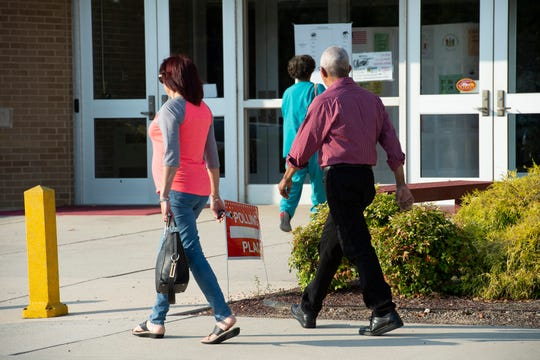 Voters heading to the polls at Milford High School.