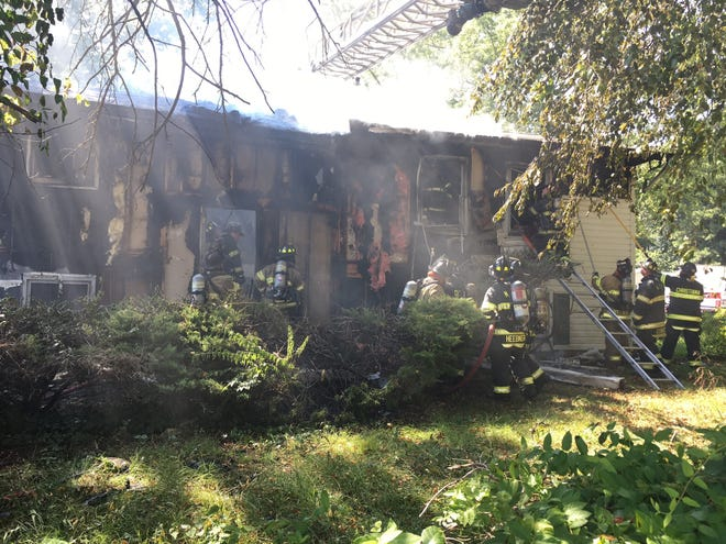A man was trapped inside a home on Scottfield Drive in Ogletown Thursday afternoon. About 50 firefighters responded to the scene and the man was rescued and hospitalized.
