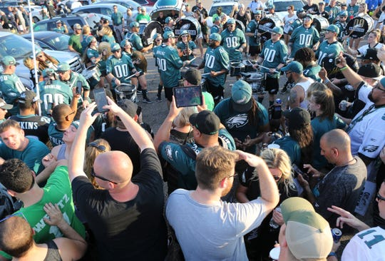 Eagles fans gather for tailgating at Lincoln Financial Field before the season opener against Atlanta Thursday.