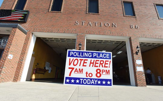 Voters head to the polls during the primaries in September.