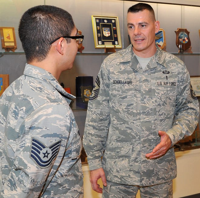 Chief Master Sergeant Marc Schoellkopf, right, speaks with TSgt. Peter Ruiz Thursday. Schoellkopf has been the Command Chief of the 80th Flying Training Wing since May 2017.