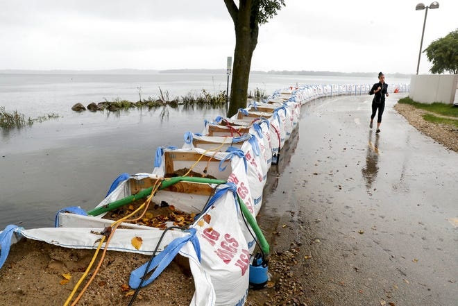 Sandbags remain protecting the Capital City Trail from Lake Monona near the Monona Terrace Convention Center in Madison, Wisconsin Wednesday Sept. 5, 2018. (Steve Apps/Wisconsin State Journal via AP)