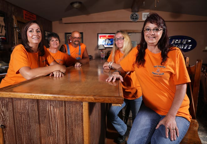 Nova Johnson, right, Terri Henner, Joe and Candy Miller and Misty Wescott, left, in the clubhouse of the Firepit Charity Club in Zanesville. The club holds several fundraising events for various causes every year.