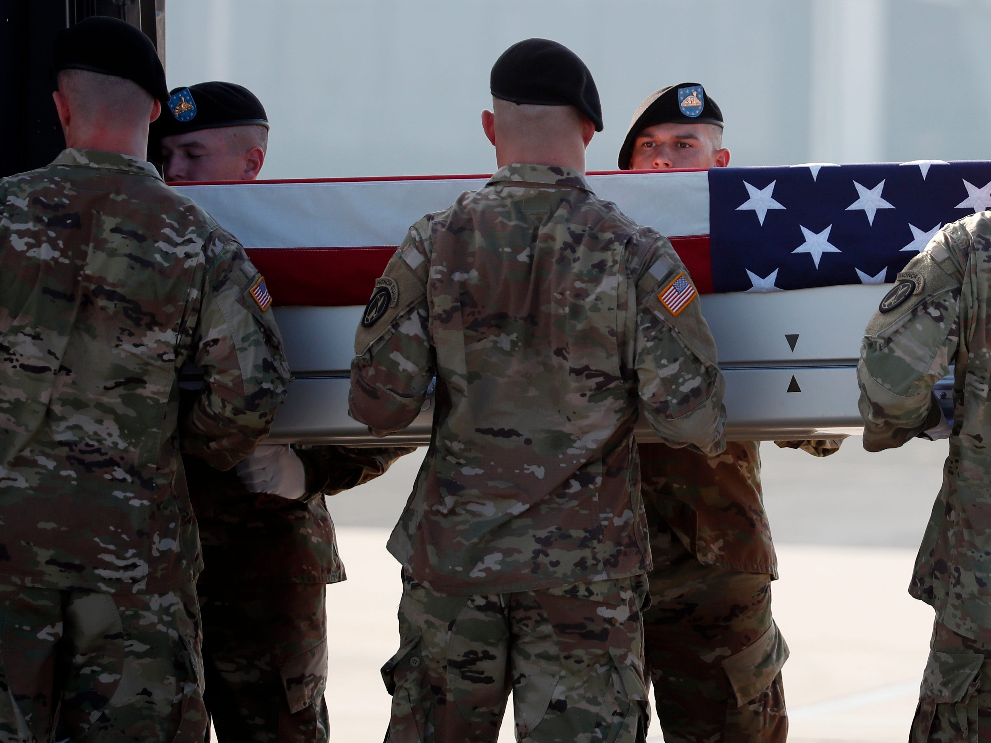 An Army carry team moves a transfer case containing the remains of U.S. Army Staff Sgt. Diobanjo S. San Agustin at Dover Air Force Base, Del. on Sept. 5, 2018, at Dover Air Force Base, Del. According to the Department of Defense, San Agustin of National City, Calif., died while supporting Operation Freedom's Sentinel.
