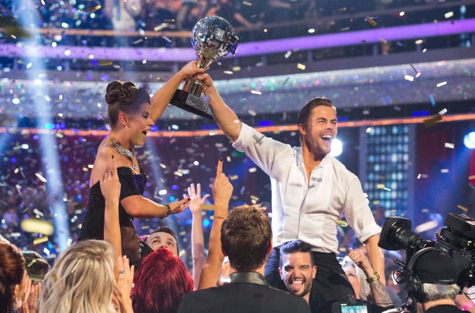Bindi Irwin, left, and Derek Hough hold the mirrorball trophy they claimed after winning Season 21 of ABC's 'Dancing with the Stars' on Tuesday.