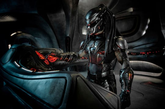 "A Predator in its spacecraft during the 2018 film ""The Predator."""