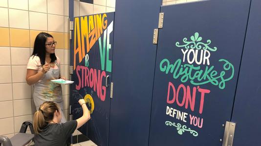 Teachers paint school bathroom