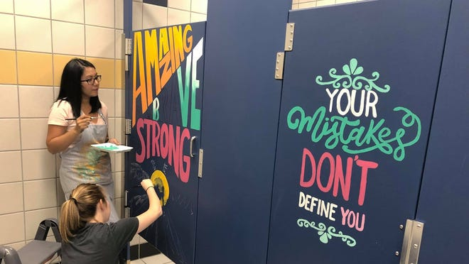 Teachers came in over the summer to paint the school's bathroom.