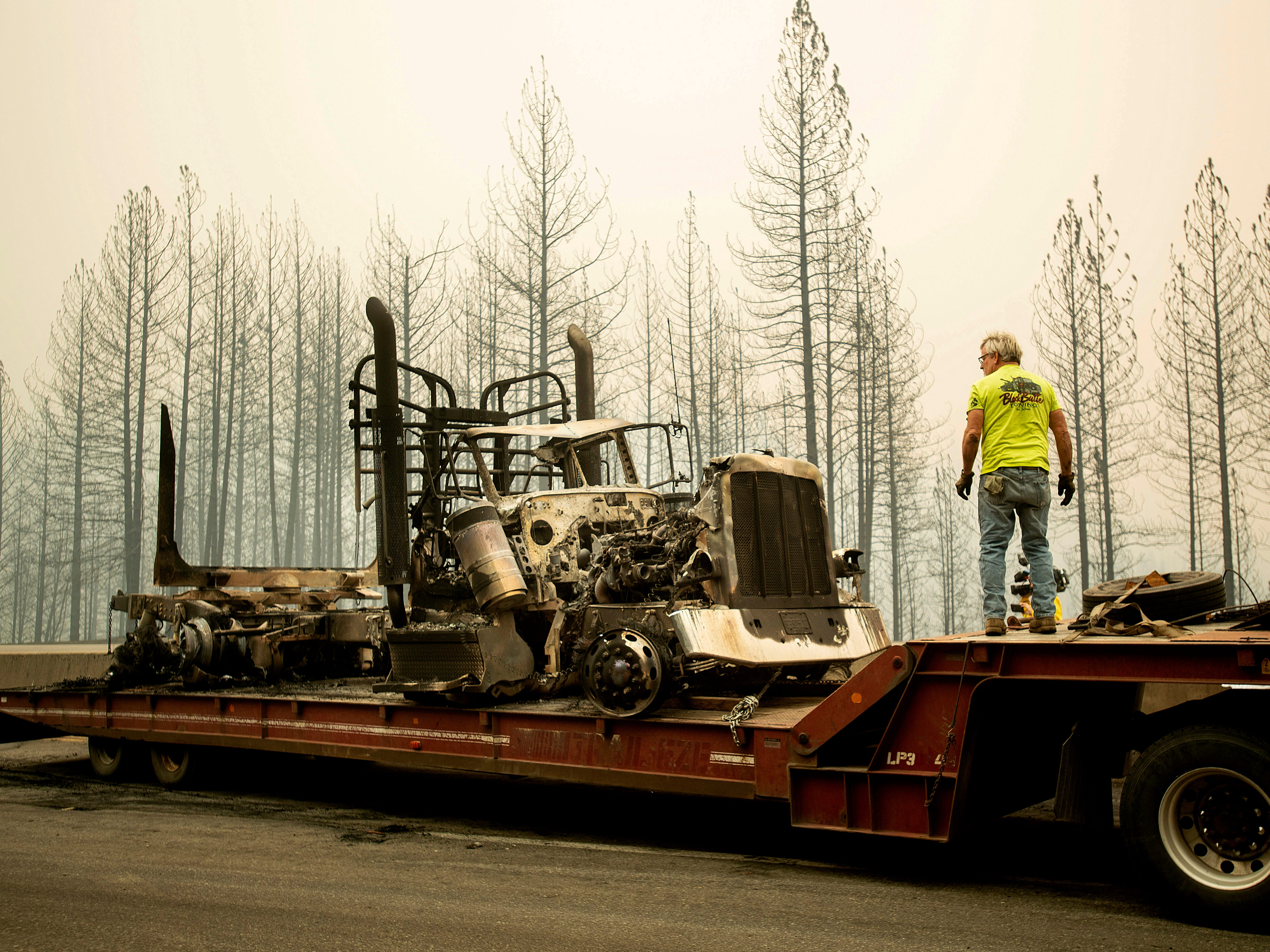 Bruce Palmer prepares to tow a truck scorched by the Delta Fire on Interstate 5 in the Shasta-Trinity National Forest, Calif., near Shasta Lake on Thursday, Sept. 6, 2018. The highway remains closed to traffic in both directions as crews battle the blaze. (AP Photo/Noah Berger) ORG XMIT: CANB101