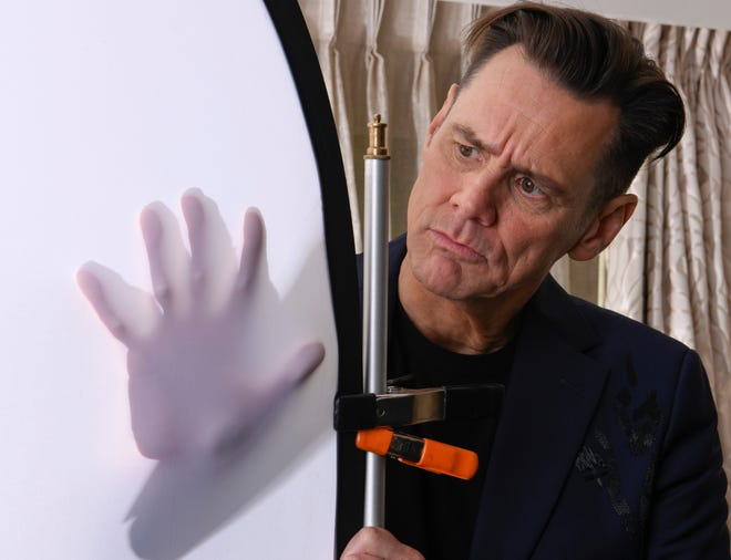 Jim Carrey immerses himself in the photographer's tools during a photo shoot for his new Showtime comedy, 'Kidding.'
