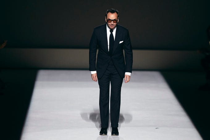 Fashion designer Tom Ford saluted the audience during his show.