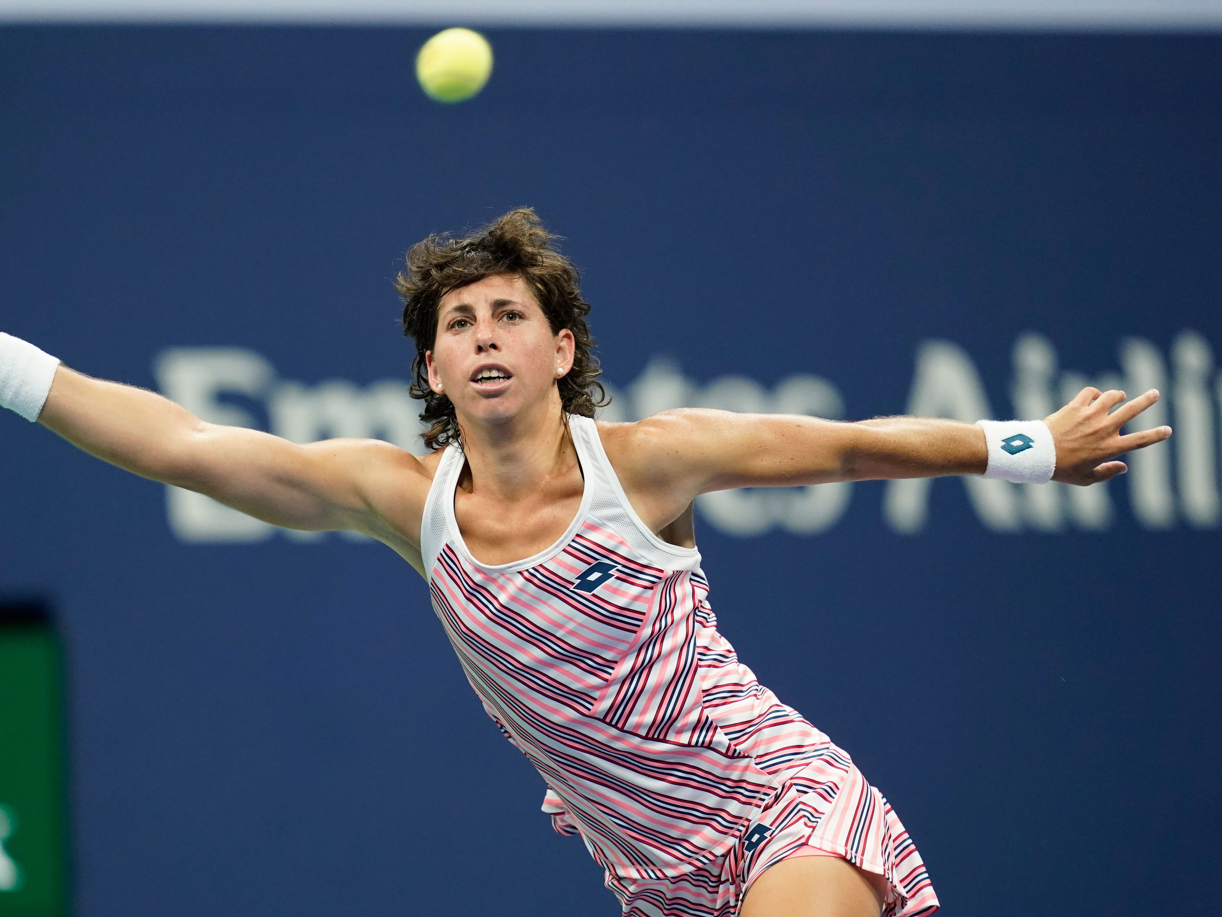 Spain's Carla Suarez Navarro stretches to hit a return to the USA's Madison Keys during their quarterfinal match.
