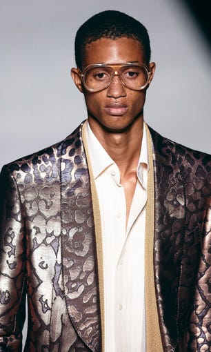 Tom Ford accessorized this look with over sized glasses.