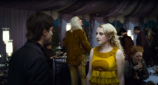 "Here's Evanna Lynch as Luna Lovegood in ""Harry Potter and the Deathly Hallows: Part 1."""
