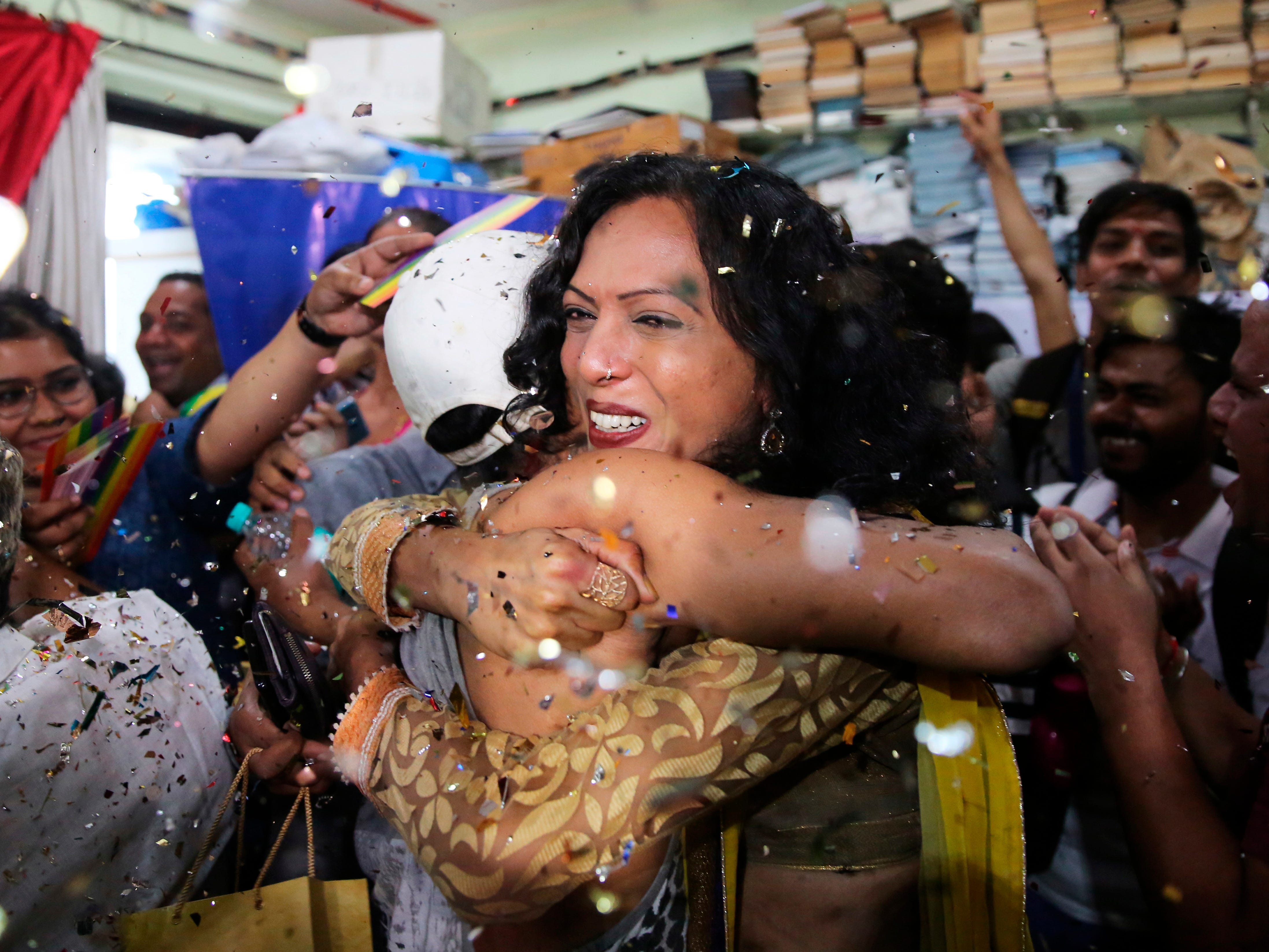 Supporters and members of the LGBT community celebrate after the country's top court struck down a colonial-era law that makes homosexual acts punishable by up to 10 years in prison, in Mumbai, India, Sept. 6, 2018.