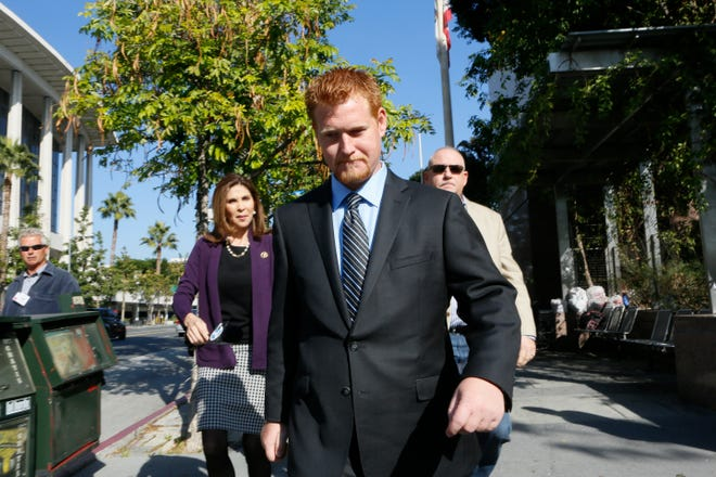 Redmond O'Neal, leaves court on Dec. 12, 2013, in Los Angles. Prosecutors have brought a number of new charges against O'Neal related to an alleged crime spree in May.