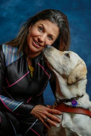 Alpine skier Danelle Umstead poses with her support dog Aziza during a Team USA portrait session.