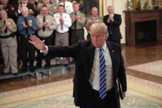 TOPSHOT - US President Donald Trump waves during a meeting with sheriffs from across the US at the White House in Washington, DC, on September 5, 2018. (Photo by NICHOLAS KAMM / AFP)NICHOLAS KAMM/AFP/Getty Images ORG XMIT: 479 ORIG FILE ID: AFP_18V91Q