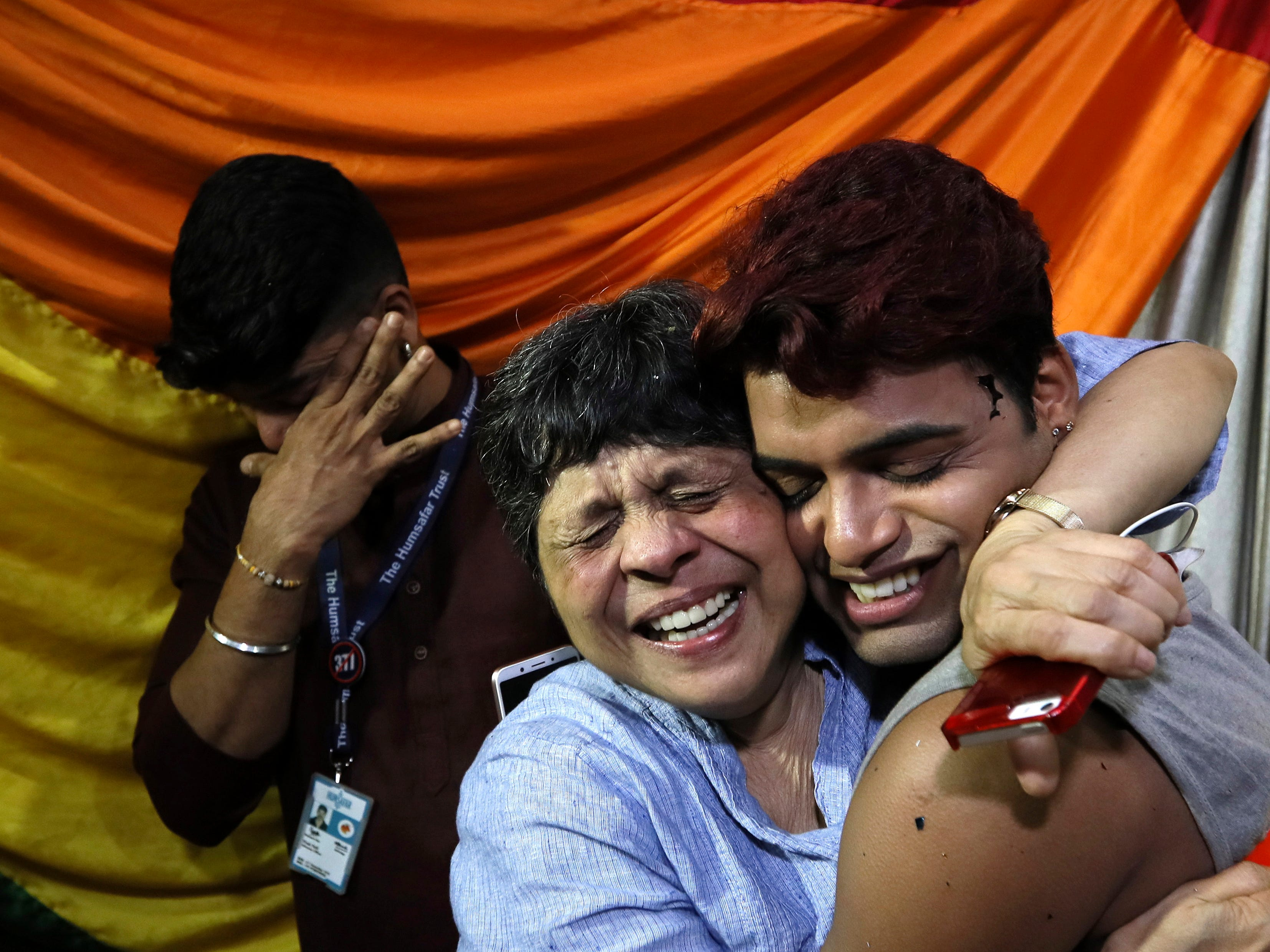 Gay rights activists react after the hearing the decision of the Supreme Court in Mumbai, India, Sept. 6, 2018.