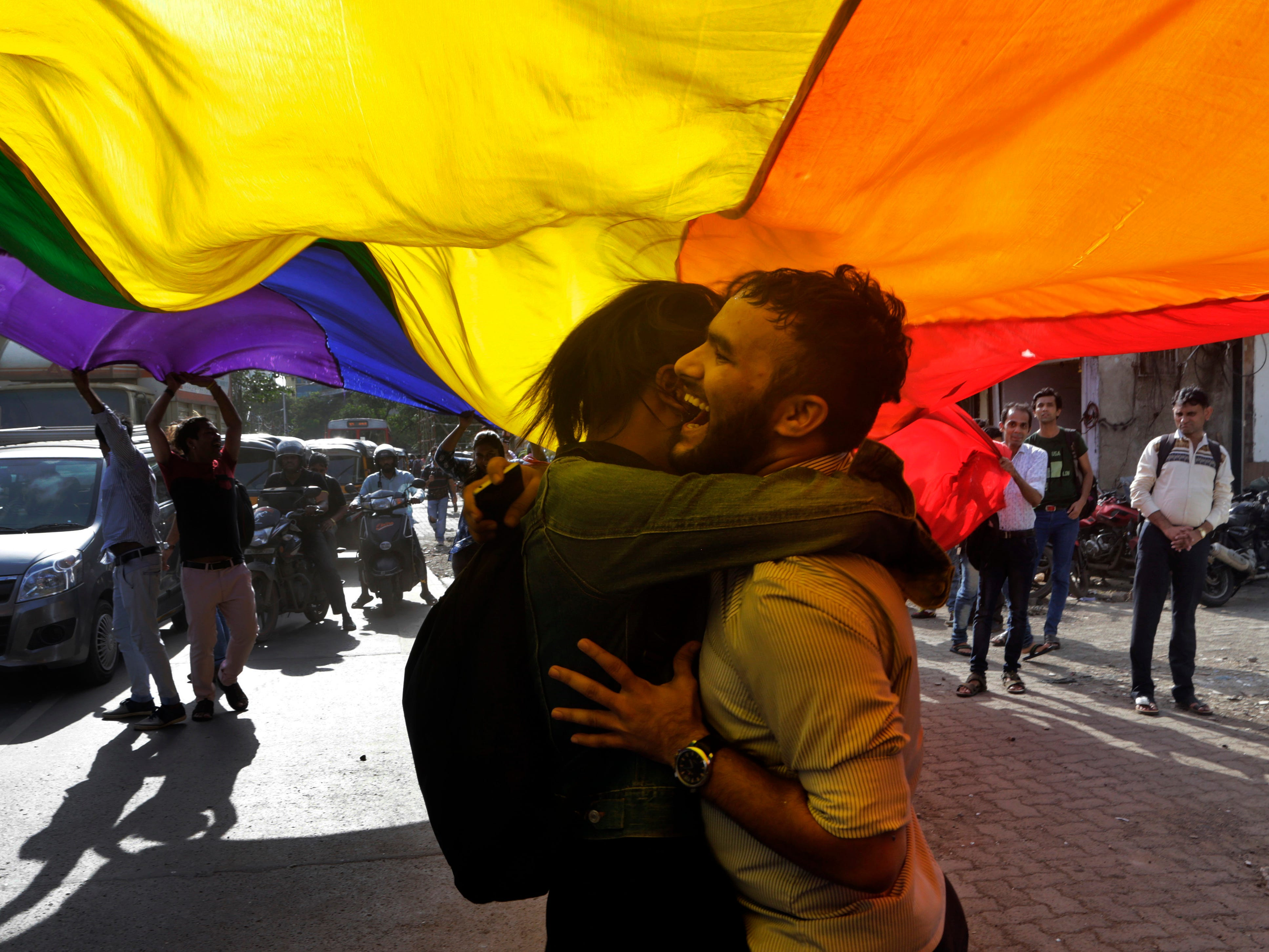 Gay rights activists celebrate after the country's top court struck down a colonial-era law that made homosexual acts punishable by up to 10 years in prison, in Mumbai, India, Sept. 6, 2018.